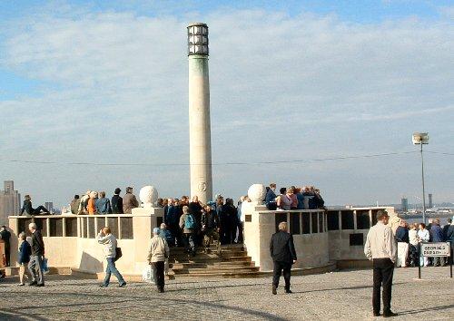 People waiting at the Merchant Navy memorial